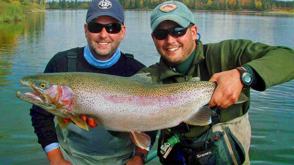 Angler and Guide with Large Rainbow Trout