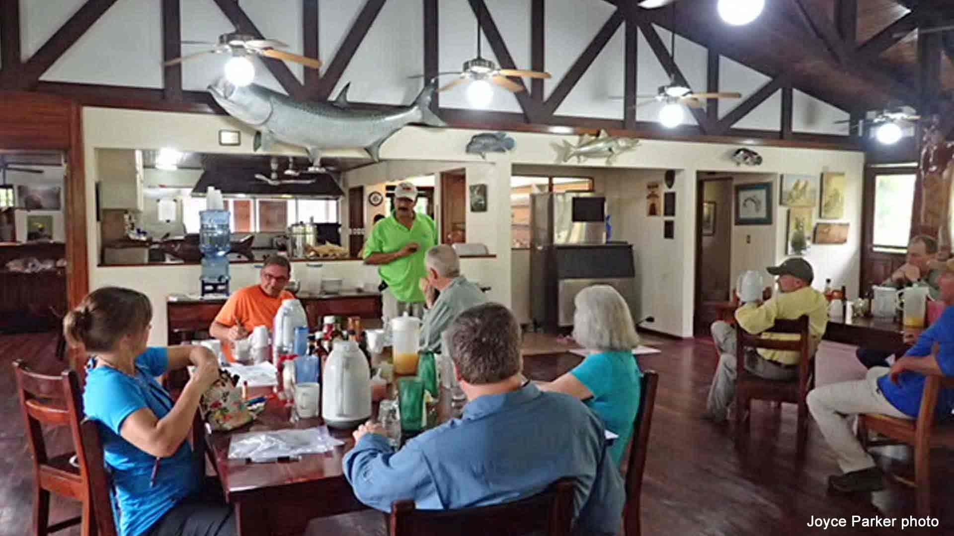 Guests Eating Breakfast in Clubhouse listening to Orientation