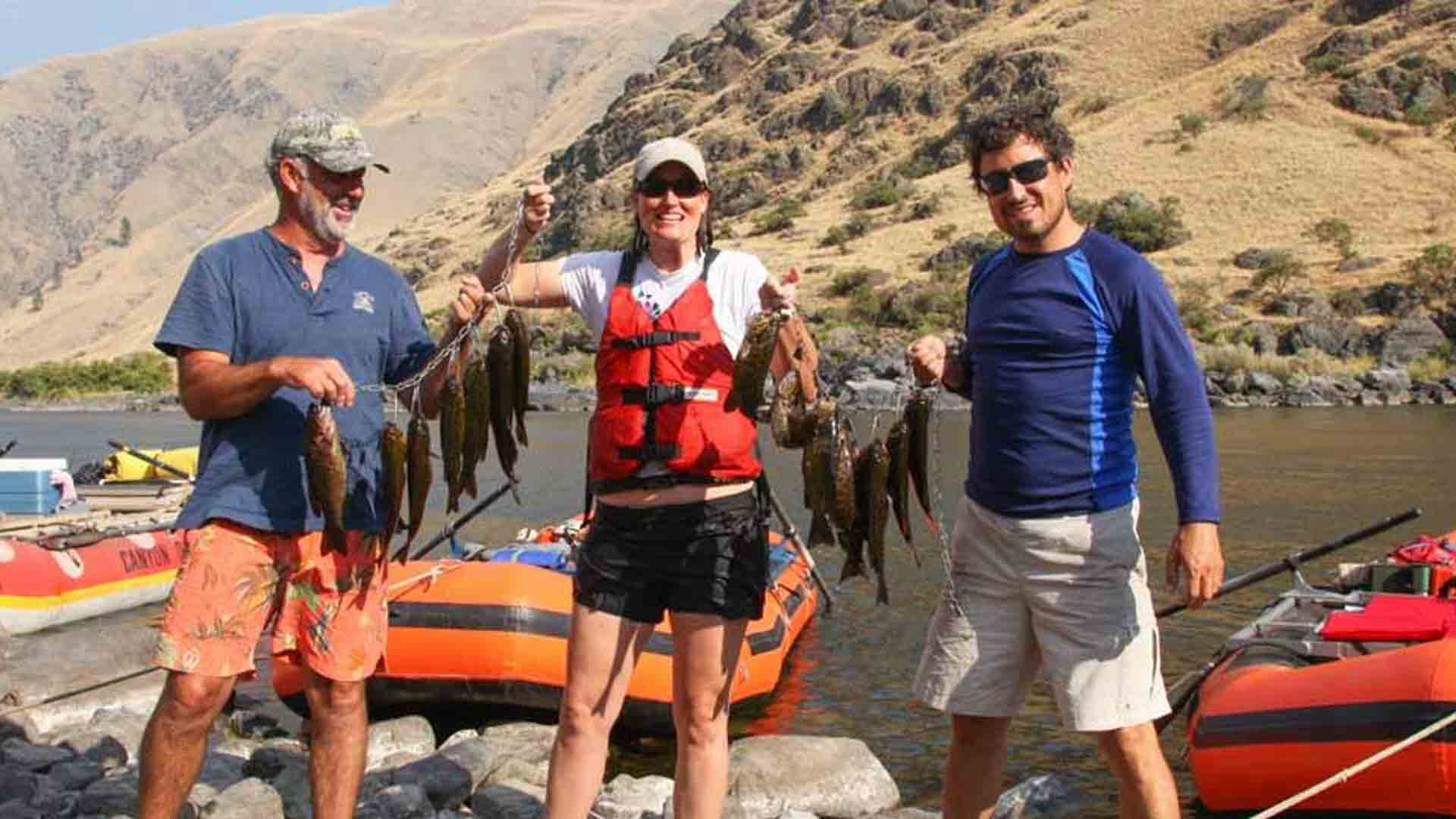 Anglers with Smallmouth Bass on Stringer