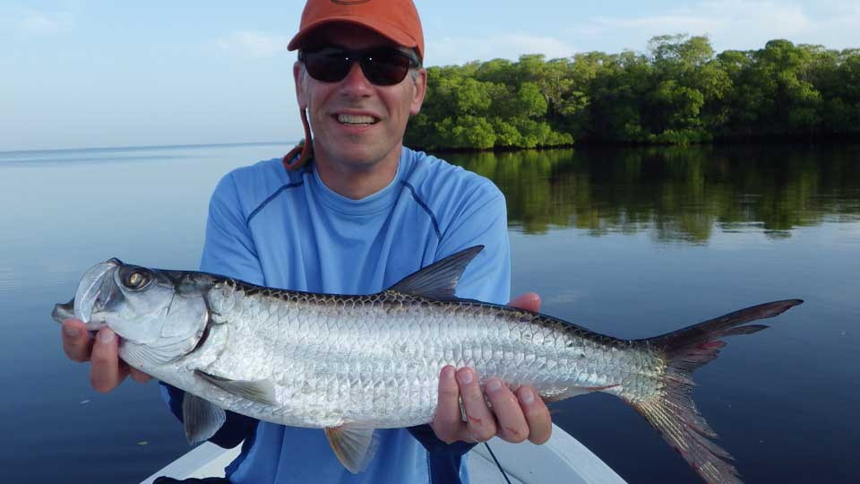 Scott Ankenbrand with baby tarpon